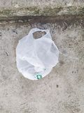 Some plastic bags can be recycled but people still left on the floor royalty free stock photo