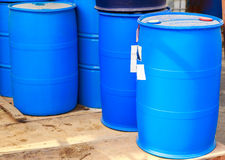Some plastic blue barrels Stock Photos