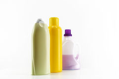 Some plastic bottles on white. A composition with some plastic bottles of different colours, staggered, white background, landscape cut stock photography