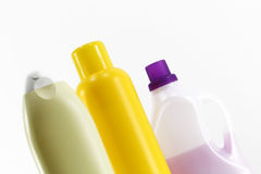 Some plastic bottles on white. A composition with three plastic bottles of different colours, staggered, white background, landscape cut stock photo