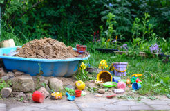 Some plastic sandbox toys. Sand toys in sandbox stock image