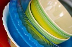 Some plates. Of the different form and color. Kitchen utensils Royalty Free Stock Photos