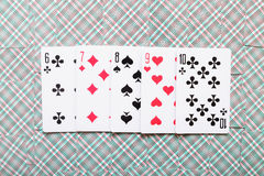 Some playing cards lays on a background of playing cards.  Royalty Free Stock Photography