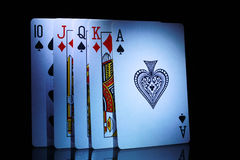 Some of playing cards, from ten to ace. In dark Royalty Free Stock Photos