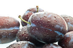 Some plums with drops of water Stock Image
