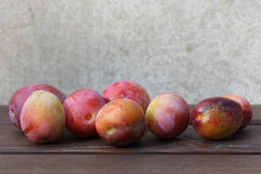 Some plums. Some plums on the wood table Royalty Free Stock Image