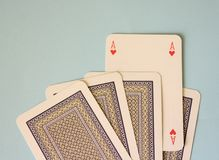 Some poker cards. On blue desk Royalty Free Stock Photo