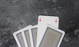 Some poker cards. On marble background Royalty Free Stock Image