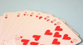 Some poker cards. On blue desk Stock Photos