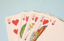 Some poker cards. On blue desk Stock Photography