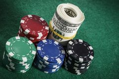 Some poker chips on the green table Stock Photos