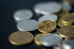 Some Polish coins scattered on a dark background. Close up stock photo