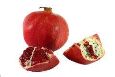 Some pomegranates. Isolated on the white Stock Images