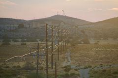 Barstow Powerlines. Some powerlines in a scant area, close the Barstow, California, in the late evening, close to sunset royalty free stock images