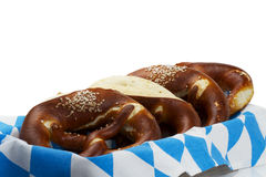 Some pretzels in a bavarian bread basket. On white background Stock Photos