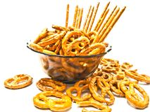 Some pretzels and breadsticks. Salted pretzels and breadsticks closeup on a plate Stock Photos