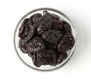 Some prunes in plate isolated. On white Stock Photography