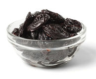 Some prunes in plate isolated. On white Stock Images