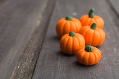 Some pumpkins on grey wooden background. With copy space royalty free stock photography