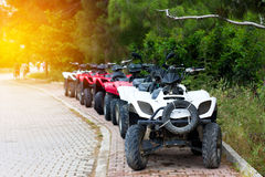Some quad bikes standing near road. Travel concept Royalty Free Stock Photo