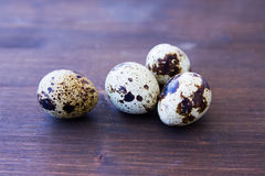 Some quail eggs on wooden. Some quail eggs on a wooden table Stock Photo