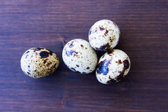 Some quail eggs on wooden top views. Some quail eggs on a wooden table top views Royalty Free Stock Photos