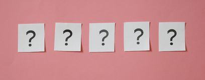 Some question marks. On pink backgorund stock images