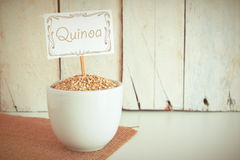 Some quinoa  seeds in a bowl in the herbalist's. Stock Images