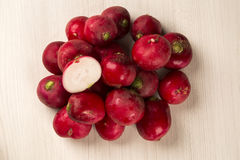 Some radishes in a basket over a white background. Fresh vegetable Stock Photo