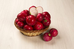Some radishes in a basket over a white background. Fresh vegetable Royalty Free Stock Images