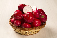 Some radishes in a basket over a white background. Fresh vegetable Stock Image