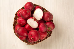 Some radishes in a basket over a white background. Fresh vegetable Stock Photos