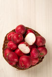 Some radishes in a basket over a white background. Fresh vegetable Royalty Free Stock Image