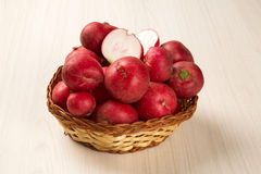 Some radishes in a basket over a white background. Fresh vegetable Royalty Free Stock Photography