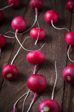 Some radishes at the table. Selective focus royalty free stock photography