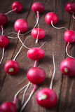 Some radishes at the table. Selective focus royalty free stock photos