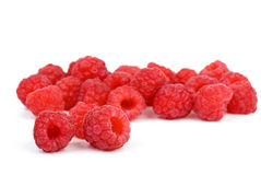 Some raspberries. Isolated on the white background. Focused on berries in the lower left corner stock photography