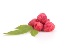 Some raspberries with leaves Stock Photos