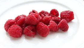 Some fresh raspberries. Some raspberries on white background royalty free stock image