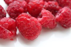 Some fresh raspberries. Some raspberries on white background Royalty Free Stock Photo