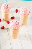 Some raspberry ice cream cones. Three raspberry ice cream cones on white wood Royalty Free Stock Photos