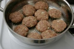 Raw meatballs in a pan. Some raw meatballs of minced meat in a pan stock image