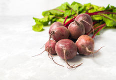 Some raw red beetroot with leaves on grey stone background. Hori. Zontal Stock Photo