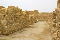 Some of the reconstructed ruins of the ancient Jewish clifftop fortress of Masada in Southern Israel. Everything below the marked. Blue lines is original royalty free stock photos