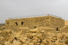 Some of the reconstructed ruins of the ancient Jewish clifftop fortress of Masada in Southern Israel. Everything below the marked. Blue lines is original royalty free stock photo