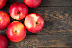 Some red apples. On the dark wooden table stock images