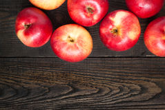 Some red apples. On the dark wooden table Royalty Free Stock Photo