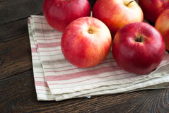 Some red apples on the napkin. At the table Royalty Free Stock Photos