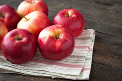 Some red apples. On the napkin at the table Royalty Free Stock Image