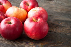 Some red apples at the  table. Some red apples at the dark wooden table Royalty Free Stock Images